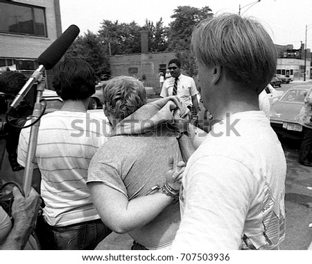 Chicago, Illinois, 28Th June, 1986 Members of the Chicago police tactical squad arrest man in bar and then take him to paddy wagon during KKK rally in the Marquette Park area.