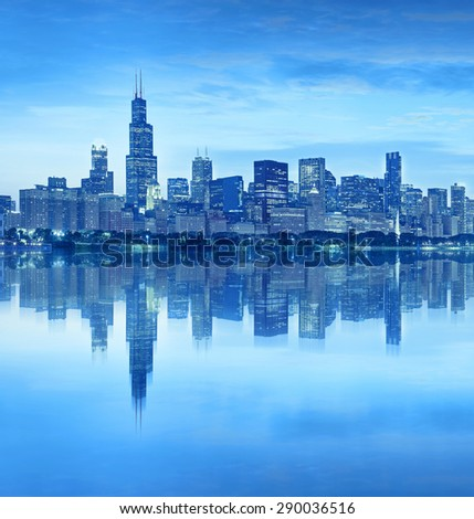 Chicago Illinois USA, blue color processed panorama of city downtown skyline at sunset with illuminated buildings, park and lake reflections - stock photo
