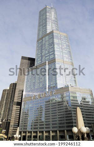 CHICAGO, ILLINOIS / USA - June 14th, 2014: A new sign with Donald Trump's name was finished on the Trump International Hotel and Tower this week in downtown Chicago.   - stock photo