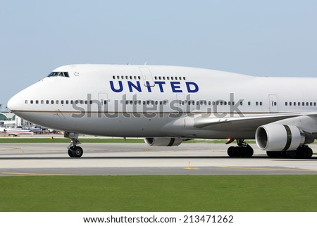 CHICAGO, ILLINOIS / USA - May 10, 2014: A United Airlines Boeing 747-400 rolling down the runway at O'Hare Airport during it's regular passenger flight.  These aircraft make frequent flights to O'Hare - stock photo