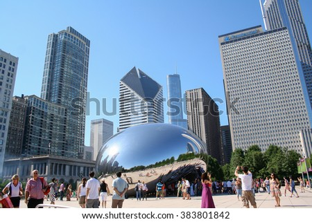 CHICAGO - JULY 29, 2011: Cloud Gate sculpture in Millenium park in Chicago, IL. This public sculpture is the centerpiece of the AT&T Plaza in Millennium Park within the Loop community area. - stock photo