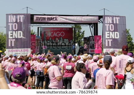 CHICAGO - JUNE 5: Participants attending the final ceremony festivities at the Avon Walk for Breast Cancer outside Soldier Field on June 5, 2011 in Chicago, IL. - stock photo