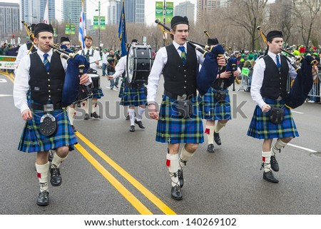 CHICAGO - MARCH 16 : Bagpipers at the annual Saint Patrick's Day Parade in Chicago on March 16 2013 - stock photo