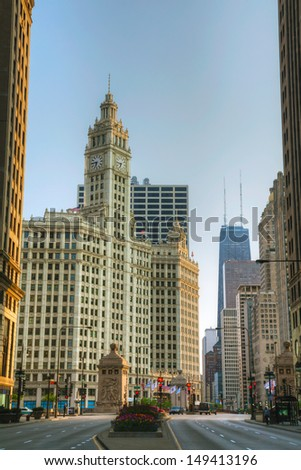 CHICAGO - MAY 18: Downtown Chicago with  the Wrigley building on May 18, 2013 in Chicago, IL. The Wrigley Building is a skyscraper located across Michigan Avenue from the Tribune Tower. - stock photo