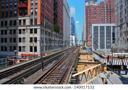 CHICAGO - MAY 19: The L in Chicago on May 19, 2012.  It is the second largest rapid transit system in total track mileage in the United States, after the New York City Subway. - stock photo