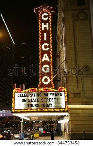 CHICAGO - OCTOBER 24, 2015: Famous Chicago sign at State Street. The Chicago Theater is a landmark theater located on North State Street in the Loop area of Chicago - stock photo