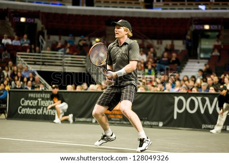CHICAGO - OCTOBER 17: Jim Courier on October 17, 2012 competing in the 2012 Powershares QQQ Challenge at the United Center in Chicago. - stock photo