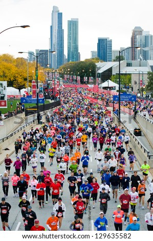 CHICAGO - OCTOBER 7: Participants in the Bank of America Chicago Marathon run along Columbus Drive on October 7, 2012 in Chicago. Over 37,000 runners completed the 2012 Chicago Marathon. - stock photo