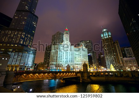 Chicago River skyline and Michigan Avenue Bridge at night, IL, USA