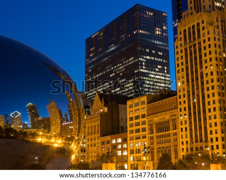 "CHICAGO - SEPTEMBER 12: The famous ""Cloud Gate"" (bean) sculpture at night with buildings reflected on it's surface and Michigan Avenue in background on September 12, 2012 in Chicago. - stock photo"