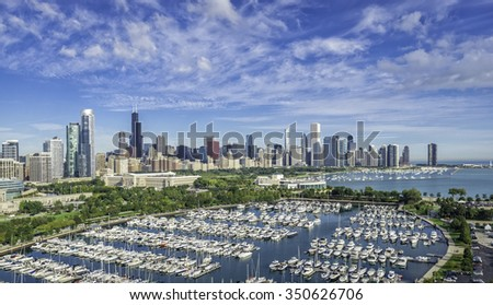 Chicago Skyline aerial view with park and marina full of boats - stock photo
