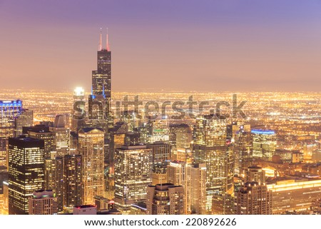 Chicago skyline aerial view with skyscrapers over Lake Michigan with cloudy sky at dusk. - stock photo