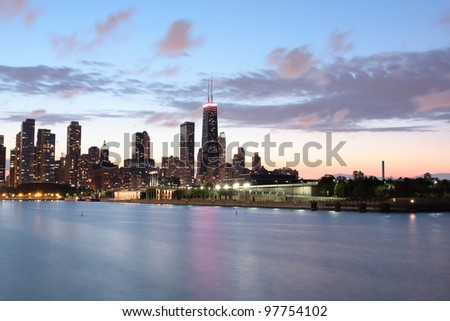 Chicago Skyline at dusk with the Hancock building and a cloudy sky - stock photo