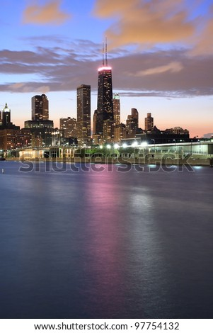Chicago Skyline at dusk with the Hancock Center building and cloudy sky - stock photo
