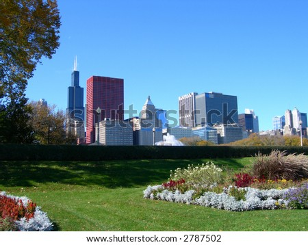 Chicago skyline from across Millennium Park, with flower beds in foreground