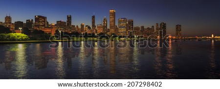 Chicago Skyline Mirrored over Lake Michigan  - stock photo
