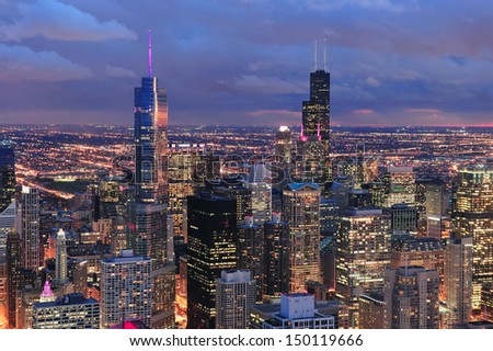 Chicago skyline panorama aerial view with skyscrapers with cloudy  sky at dusk. - stock photo