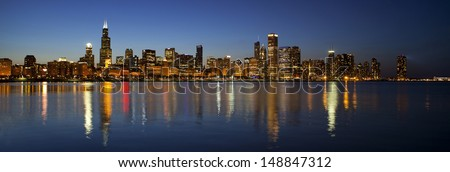 Chicago Skyline panorama view over Lake Michigan at dusk - stock photo