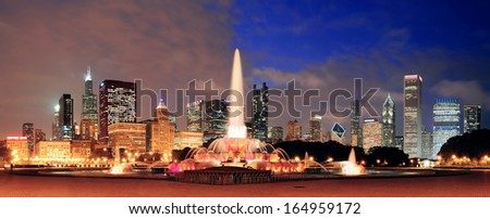 Chicago skyline panorama with skyscrapers and Buckingham fountain in Grant Park at night lit by colorful lights. - stock photo