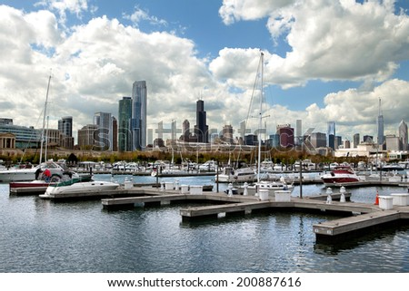Chicago skyline view from Burnham Harbor with docked boats  - stock photo