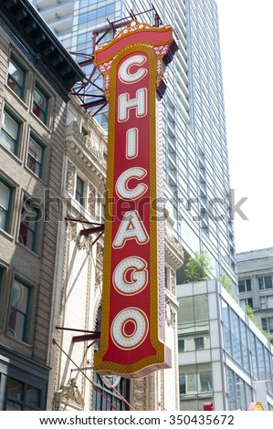 Chicago Theater, formerly the Balaban and Katz Chicago Theater in Chicago, Illinois. The word Chicago is written on a red board. Skyscrapers are seen on the background.
