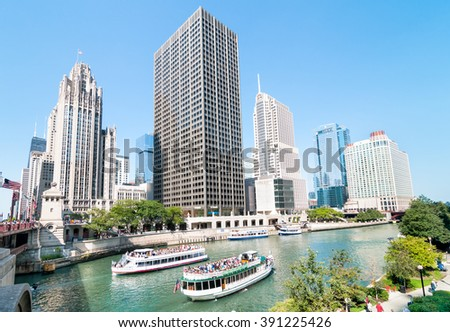 CHICAGO, UNITED STATES - AUGUST 15, 2014: Chicago Architecture Foundation River Cruise, boats traveling towards Lake Michigan.  - stock photo