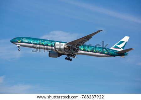 "Chicago, USA - December 4, 2017: Cathay Pacific ""The Spirit of Hong Kong"" Boeing 777-300 aircraft on final approach to O'Hare International Airport."