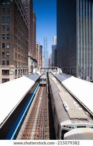 CHICAGO,USA-JULY 11,2013: Famous elevated overhead commuter train in Chicago. - stock photo