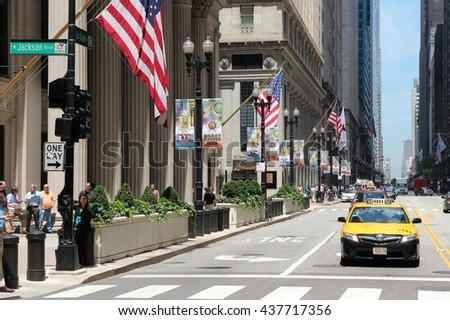 CHICAGO, USA - JUNE 27, 2013: People walk along LaSalle Street in downtown Chicago. Chicago is the 3rd most populous US city with 2.7 million residents (8.7 million in its urban area).