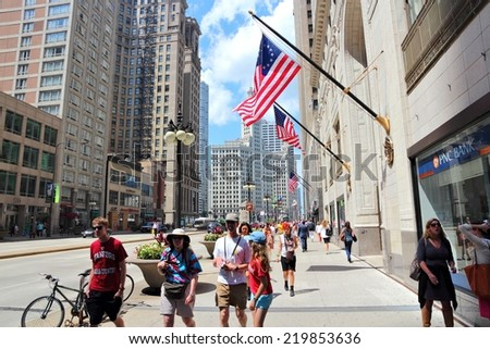 CHICAGO, USA - JUNE 27, 2013: People walk downtown in Chicago. Chicago is the 3rd most populous US city with 2.7 million residents (8.7 million in its urban area).