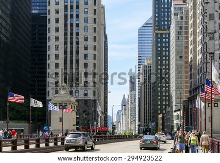 CHICAGO, USA - MAY 24, 2014: Michigan Avenue at DuSable bridge in Chicago with cars and pedestrians passing by.