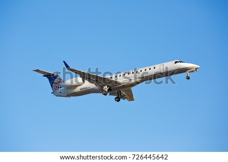 Chicago - USA - October 2, 2017: A United Airlines Embraer  ERJ-145 aircraft landing at O'Hare International Airport.