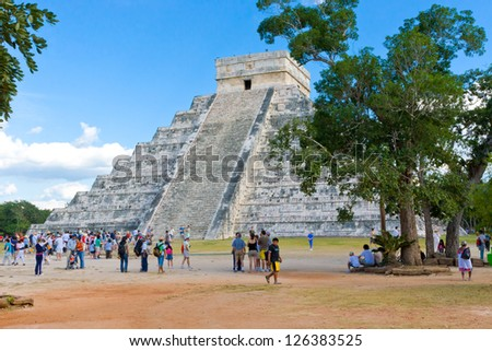 CHICHEN ITZA, MEXICO - DECEMBER 26: Tourists visiting Chichen Itza, one of the most visited archaeological sites in Mexico on December 26, 2007. About  1.2 million tourists visit the ruins every year.