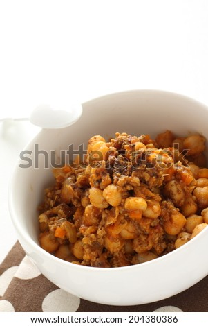 Chick pea curry with garam masala spicy powder on top