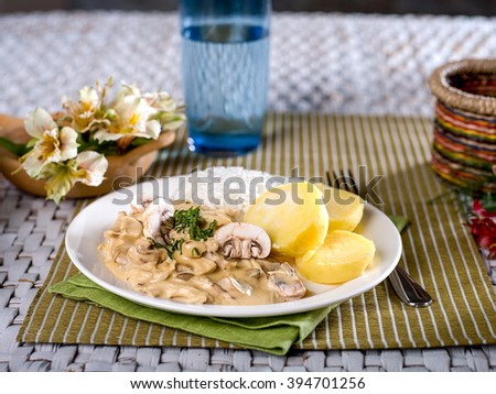 Chicken a la King with rice and potatoes - stock photo