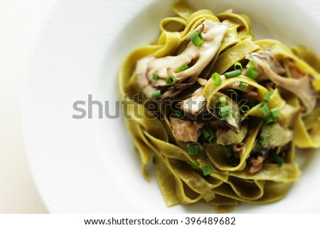 chicken and Eggplant fettuccine - stock photo