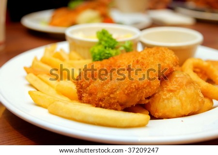 Chicken and fish cutlets with french fries - stock photo