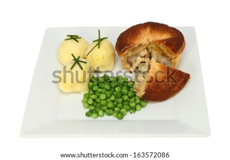 Chicken and mushroom pie with mashed potato and peas on a plate isolated against white - stock photo