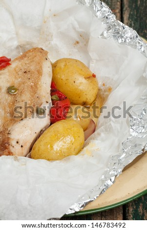 Chicken and potatoes cooked in a bag - stock photo