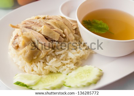 Chicken and rice is steamed for food on dish - stock photo
