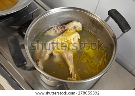Chicken and the stock soup for next step cooking - stock photo