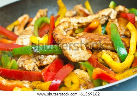 chicken and vegetables stir fried for fajitas - stock photo