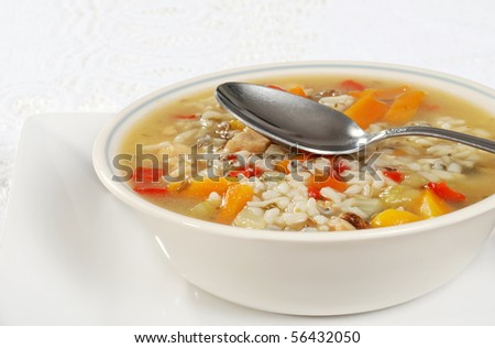 chicken and wild rice soup with spoon - stock photo