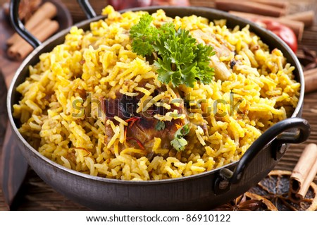 Chicken Biryani in small wok - stock photo