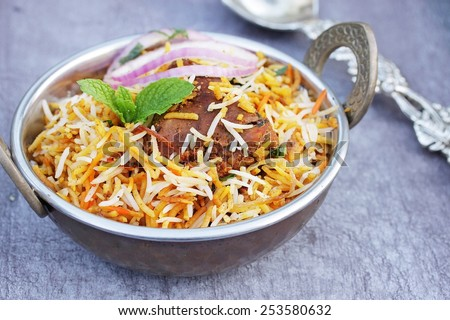 Chicken biryani served in a traditional vintage dish - stock photo