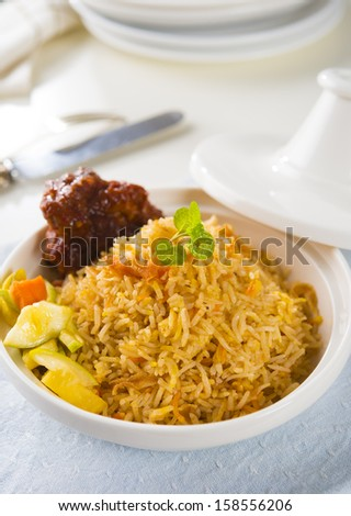 chicken biryani served with crockery - stock photo