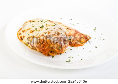 Chicken breast cooked in tomato and parmesan cheese sauce on white plate on white background with copy space - stock photo