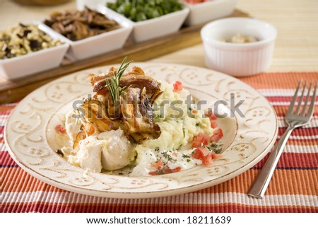 Chicken breast, grilled ham with mash potatoes, grated with cheese - stock photo