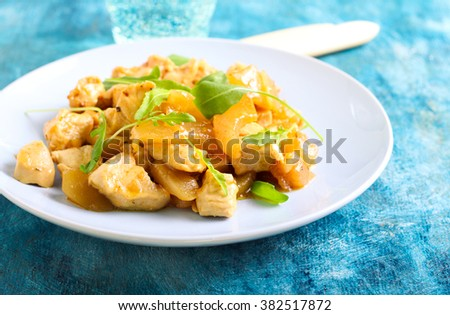 Chicken breast, pear and rocket warm salad in a plate - stock photo