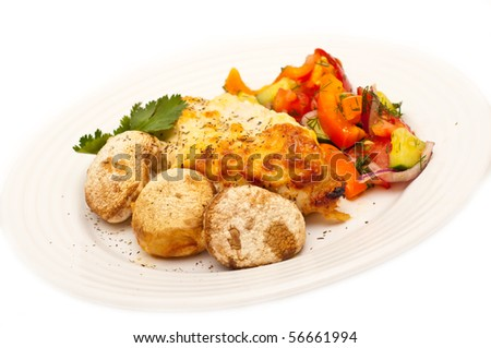 chicken breast served with mushrooms and greek salad isolated